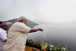 Prime Minister Narendra Modi offers prayers to Narmada River during the inauguration of Sardar Sarovar Dam at Kevadiya in Narmada district.