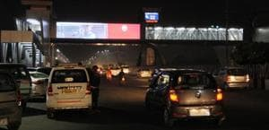 The 'running display screens' set up on both sides of a foot over bridge (FoB) near a mall appear to distract drivers.