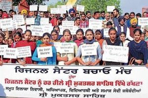 People staging a protest against shifting of the regional centre in Muktsar.