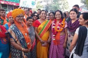 Gujarat chief minister's wife Anjali Rupani (in pink) carries out  canvassing in BJP leader's Rajkot West constituency.