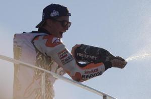 Marc Marquez of Repsol Honda celebrates his 2017 MotoGP title victory on the podium of the Valencia Grand Prix at the Ricardo Tormo Circuit on November 12.