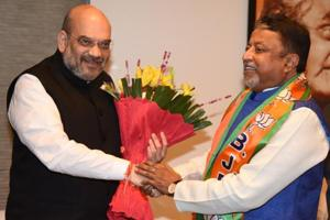 Former Trinamool Congress leader  Mukul Roy with BJP national president Amit Shah.