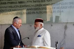 PM Narendra Damodardas Modi shakes hands with Israeli Prime Minister Benjamin Netanyahu after signing the guestbook at the Yad Vashem Holocaust memorial museum in Jerusalem on July 4 2017. In July, Modi became the first Indian Prime Minister to visit Israel.