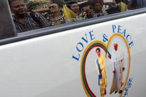 Pope meeting Suu Kyi on Myanmar refugee crisis amid outcry