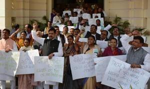 Opposition legislators protesting outside the Bihar legislative assembly building in Patna.