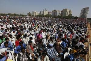 People attend an election rally in Gandhinagar. The Election Commission data shows its agencies have confiscated over £3,000 and 30,000 Thai baht from Navsari and Bardoli in Gujarat from money exchange dealers.