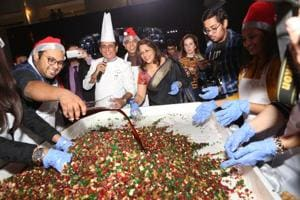 Chef Davinder Kumar (centre), vice president food and beverage production at Le Meridien Delhi, along with guests at the cake mixing ceremony.