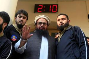 Mumbai terror attacks mastermind Hafiz Saeed speaks to supporters after attending Friday Prayers in Lahore on November 24.