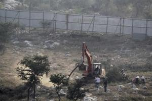 Over 10,000 trees have been axed from a 52-acre plot in Faridabad's Sarai Khajwa village for a group housing project.