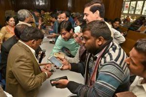 People at the draw of DDA housing scheme at Vikas Sadan in New Delhi on Thursday.