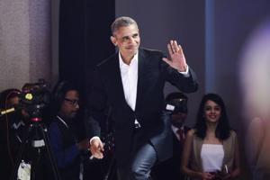 Former US president Barack Obama arrives the Hindustan Times Leadership Summit in New Delhi on Friday.