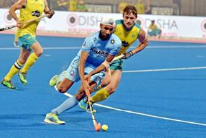 Australian defenders chase Mandeep Singh of Indian hockey team, who scored in their Pool Bopening matchof the FIHMen's Hockey World League Final in Bhubaneswar on Friday.