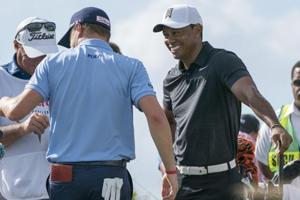 Tiger Woods did not show any sign of pain as he finished day one of the Hero World Challenge with a three-under score.