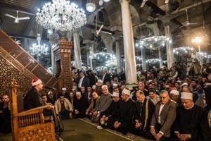 Worshippers pack Egyptian mosque a week after massacre which killed...