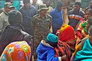 A police officer talking to villagers at Bagma village  in Jharkhand's Khunti district where a local BJP leader, Bhaiya Ram Munda was shot dead by suspected PLFI  activists on Friday.
