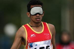Ankur Dhama races in the Men