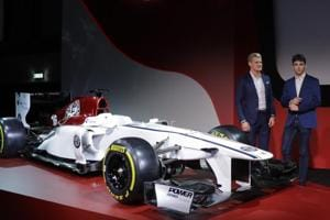 Drivers Marcus Ericsson of Sweden (left) and Charles Leclerc of Monaco unveil the Alfa Romeo Sauber F1 team car on the occasion of its official presentation in Arese, Italy, on Saturday. The Alfa Romeo Sauber F1 Team will compete in the 2018 Formula One World Championship.