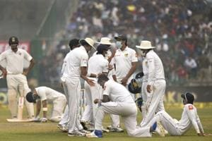 Sri Lanka cricket team players wear anti-pollution masks on the field as the air quality deteriorated during the second day of their third Test against Indian cricket team at Frerozeshah Kotla stadium  in New Delhi on Sunday.