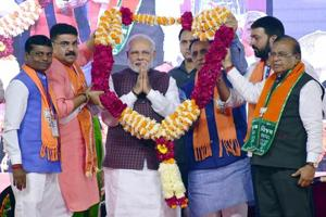 Prime Minister Narendra Modi being felicitated during an election campaign rally for the state assembly election in Rajkot on Sunday.
