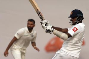 Angelo Mathews (R) plays a shot off a delivery from Mohammed Shami during the third day of the third Test match in New Delhi.