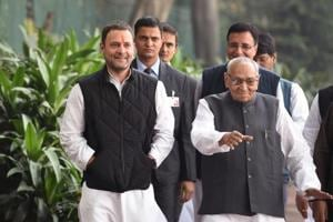 Congress Party Vice President Rahul Gandhi (L) walks with party leader Motilal Vora as he arrives to file his nomination papers for the post of party president at the All India Congress Committee office in New Delhi, on December 4, 2017.