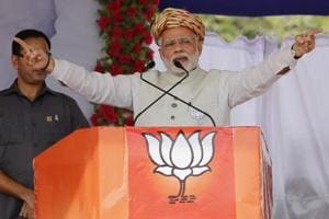 Prime Minister Narendra Modi speaks during an election campaign rally at Surendranagar in Gujarat on Sunday.