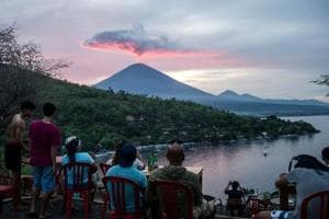 Flights resume as Bali volcano dissipates into a wispy plume of steam
