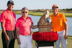 Rickie Fowler (extreme right) clinched the Hero World Challenge with a course record 11-under while Tiger Woods made a strong golf comeback after a long layoff due to back injury.