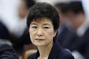 2 ex-spy chiefs charged with bribing former South Korean president