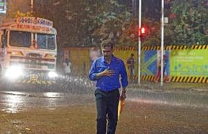 Prelude to Ockhi. A man cross the road in heavy rain at Dadar in Mumbai  as the city braces for cyclone Ochki.