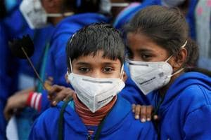 Children wearing masks attend a demonstration to spread awareness on the problem of air pollution in New Delhi.