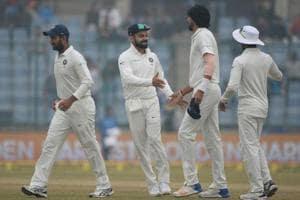 India captain Virat Kohli (2 L) celebrates with Ishant Sharma the dismissal of Sri Lanka captain Dinesh Chandimal during the fourth day of third Test .