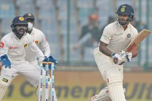 Indian batsman Shikhar Dhawan (R) plays a shot en route to his third half-century vs Sri Lanka.