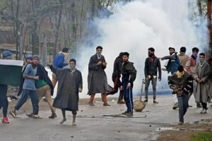 A group of youth pelting stones on security forces in Chadoora area of Kashmir