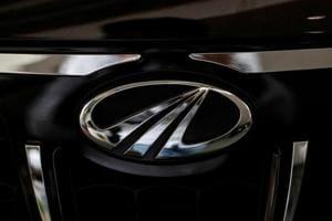 The logo of Mahindra and Mahindra is seen on a car at a showroom in Mumbai.
