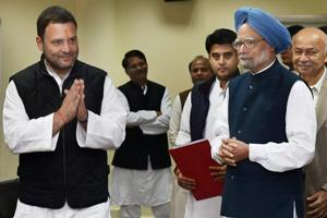 Rahul Gandhi (left) with former prime minister Manmohan Singh and other Congress leaders after filing his nomination papers for the post of party president, at the AICC office in New Delhi on Monday.