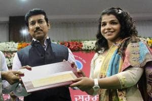 Madhya Pradesh chief minister Shivraj Singh Chouhan along with Union minister for sports Rajyavardhan Singh Rathore and state minister for sports and youth welfare Yashodhara Raje Scindia felicitating Rio Olympics bronze medallist wrestler Sakshi Malik with a cheque of Rs 25 Lakh during a ceremony at TT Nagar Stadium in Bhopal on Tuesday.