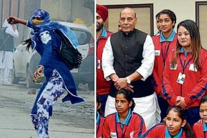 Afshan Ashiq, who had pelted stones during a protest in the Valley, stands to the left of Union home minister Rajnath Singh in New Delhi on Tuesday.