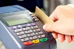 RBI says it will rationalise charges on debit card transactions
