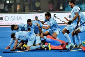 Indian hockey team players celebrate with goalkeeper Chikte Akash after beating Belgium in sudden death shootout to enter the semifinals of the FIH Hockey World League Final (HWLF) at Kalinga Stadium in Bhubaneswar on Wednesday.