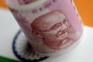 Rupee falls 14 paise to 64.52 as RBI keeps rates unchanged, raises...