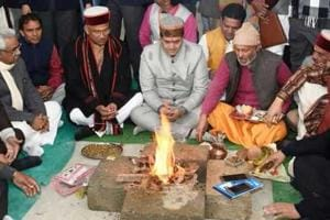 Rawat with ministers and MLAs participate at the 'havan' inside the assembly.