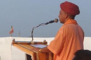 Uttar Pradesh chief minister Yogi Adityanath addressing a public meeting in Gujarat.