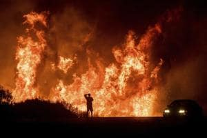 Photos: Multiple wildfires in California cause mass evacuations,...