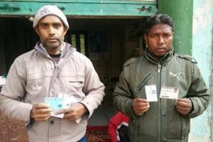 Afrazul's nephew and son-in-law with documents and identity cards of the deceased.