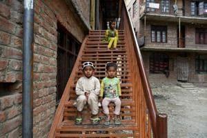 Rohingya children outside a house on the outskirts of Srinagar.