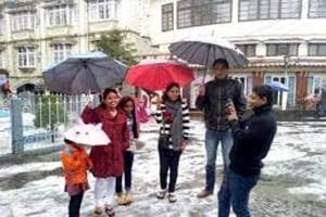 File photo of tourists enjoying snowfall in north Bengal hills. The hill stations of Darjeeling, Kalimpong and Kurseong have been popular as tourist destinations for generations.