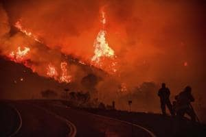 In pics: California wildfires force 120,000 to flee as blazes tear...