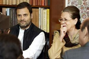 Outgoing Congress president Sonia Gandhi (right)with her son and party vice-president Rahul Gandhi.
