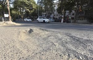 A broken road in Gurgaon's South City 2.  The colony was developed by Unitech in 1990.